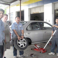 staff working on car